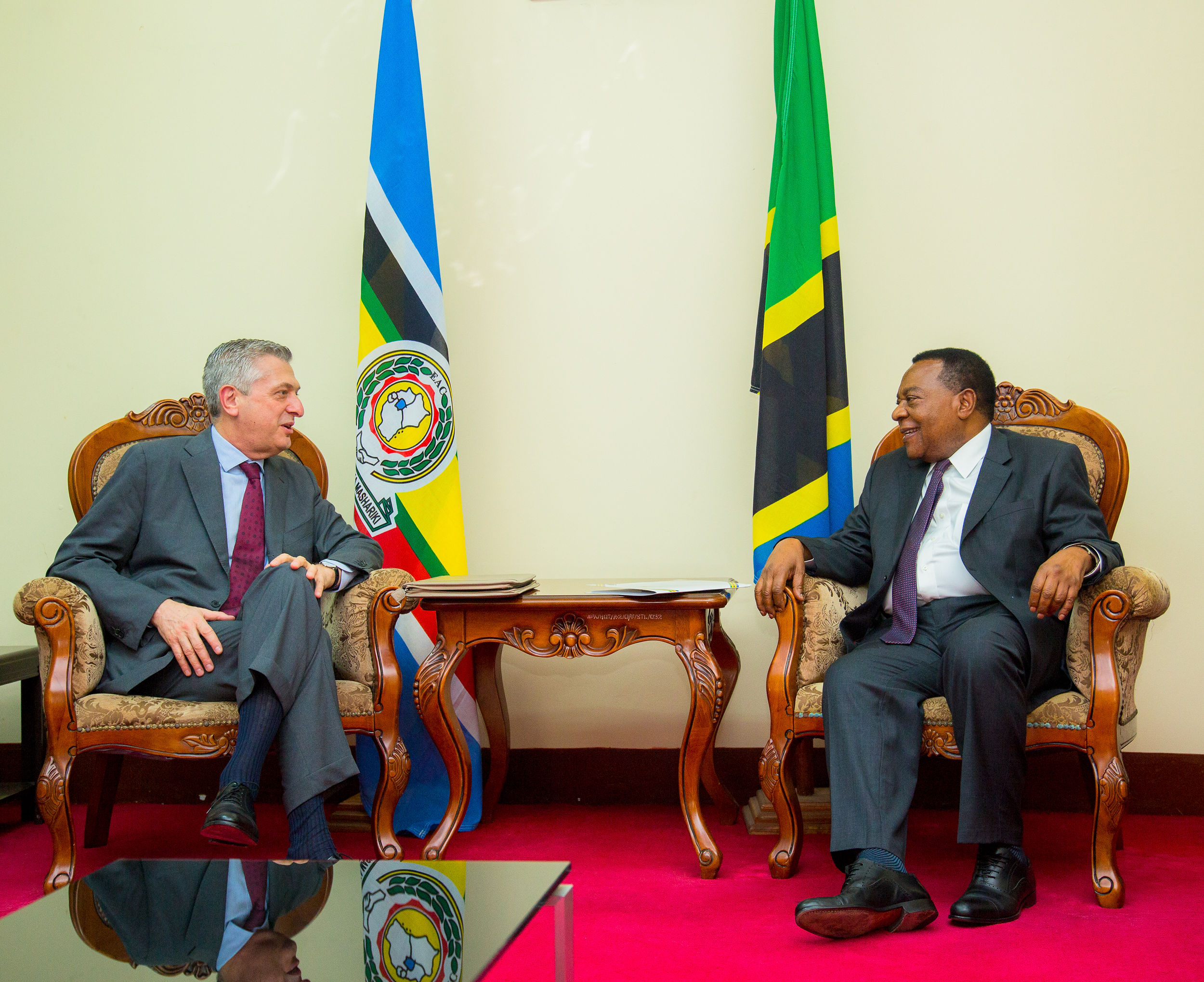 The High Commissioner of UNHCR Mr. Filippo Grandi (left) having a discussion with the Minister of Justice and Constitutional Affairs Hon. Augustine Mahiga (right).